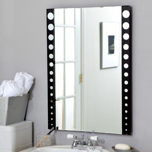 Frameless Film Strip Wall Mirror - 23.6W x 31.5H in. by Decor Wonderland. $189.99. Ready to hang with included mounting hardware. 31.5H x 23.5W x .5D inches. Crafted from beveled 3/16-inch glass. Double-coated silver metal backing and seamed edges. Frameless design with film strip border. The Frameless Film Strip Wall Mirror takes a cool idea and turns it into a modern accent for your room. This frameless glass mirror is decorated with a ''film strip'' style design silk-scree...
