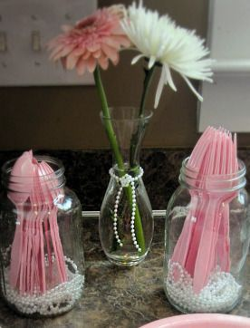 Using pearls in the decor. Used loose pearls in the bottom of mason jars for wooden spoons, straws and pens. also strung a bunch and used on tables