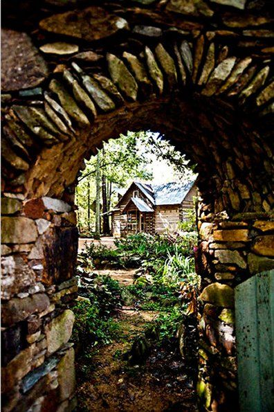 """(via """"creative inspiration"""")   This stone archway draws the eye in, and, like a frame, it directs our attention to the Log Cabin in the background...  Love this."""