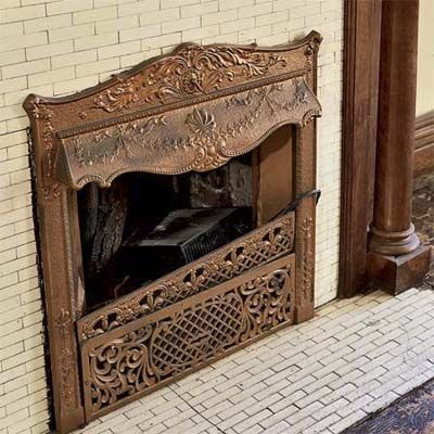 The end of the 19th century saw a transition from marble fireplace mantels to elaborate mirrored mantels made of wood. But the rectangular tile that surrounds the coal-burning fireplace insert shown here was just as important.