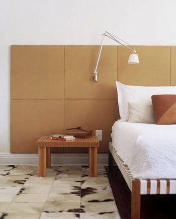 Изголовье кровати выполненное #Spinneybeck из оранжевой кожи