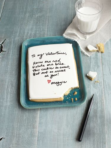 So sweet! Write a love letter on a sugar cookie with food-safe markers.     #valentinesday