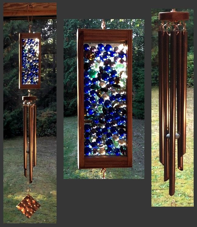 Make garden art piece with wooden frame, glass and Dollar Store half marbles. Like the top of this windchime on Etsy.