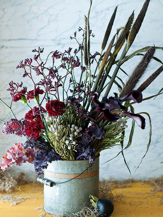 For an organic look straight out of nature, be a little eclectic in your fall display and arrangements. Gather a variety of flowers, stems, fillers, and twigs and arrange at random. Use a rustic or vintage-looking vessel, such as a galvanized bucket, to complete the look