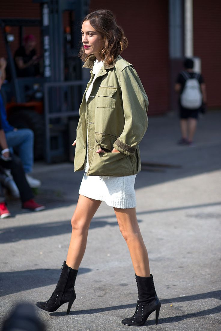 Alexa Chung goes tomboy glam in this army style jacket, sweater dress and black heeled booties. See all the street style looks from day 5 of NYFW here: