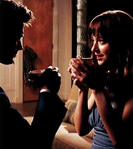 Champagne in tea cups / Anastasia Steele / Christian Grey / Jamie Dornan / Dakota Johnson / Fifty Shades Of Grey / graduation toast