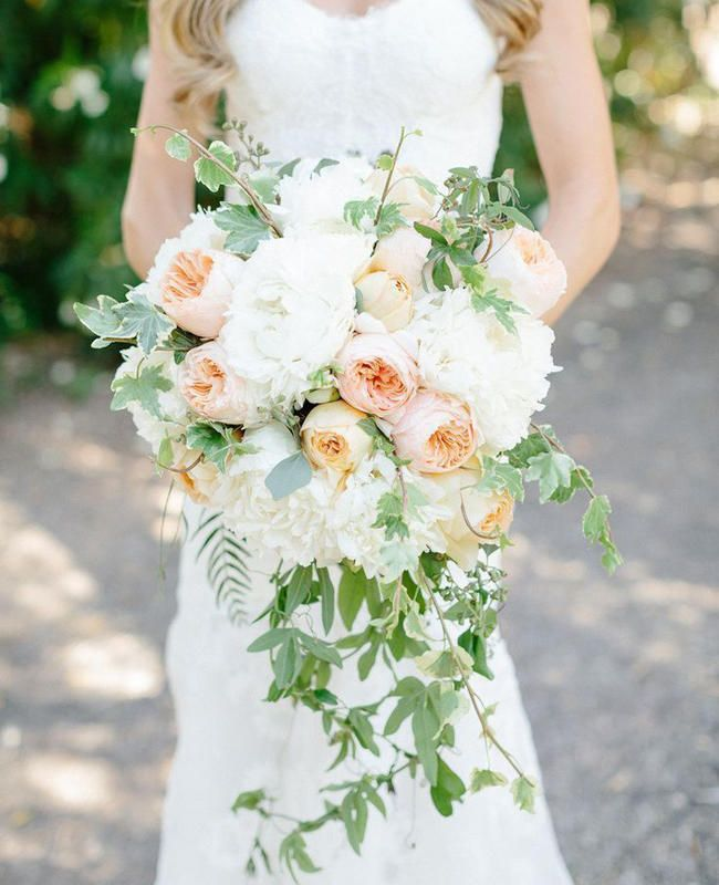 13 Modern Cascading Wedding Bouquets   Photo by: Photo: Erin Hearts Court   TheKnot.com. I like the idea of adding greenery to cascade.