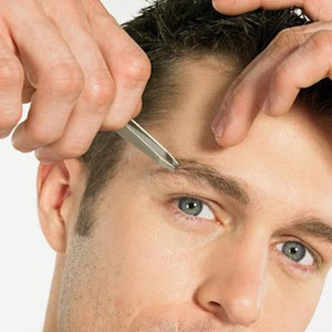 Should guys tweeze or wax their eyebrows? Get the answer to this and other men's grooming questions here.