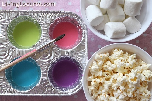 Paint popcorn and marshmallows with colored milk for a fun (and edible!) activity.