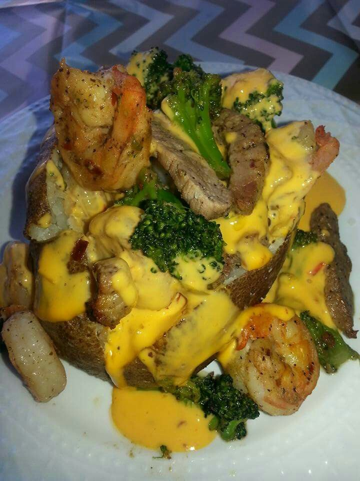 Loaded baked patato with steak strips and shrimp !