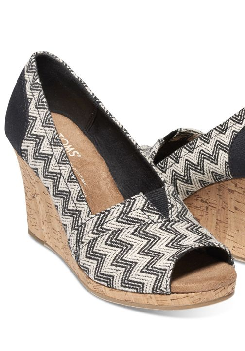 Featuring a chic chevron print and a stylish cork sole, this peep-toe wedge is ready to take you from sunny days to warm nights.