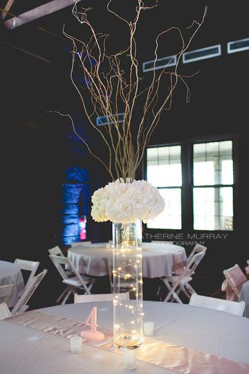 Tall hydrangea and curly willow centerpieces with vase wrapped with fairy lights. Photo from WEDDING - JASON + KATIE collection by Katherine Murray Photography