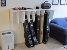 Standing storage for guitar cases. Maybe the dividers could be made long enough for the mandolin and fiddle too? Then the clarinet could go on top. #guitarcase