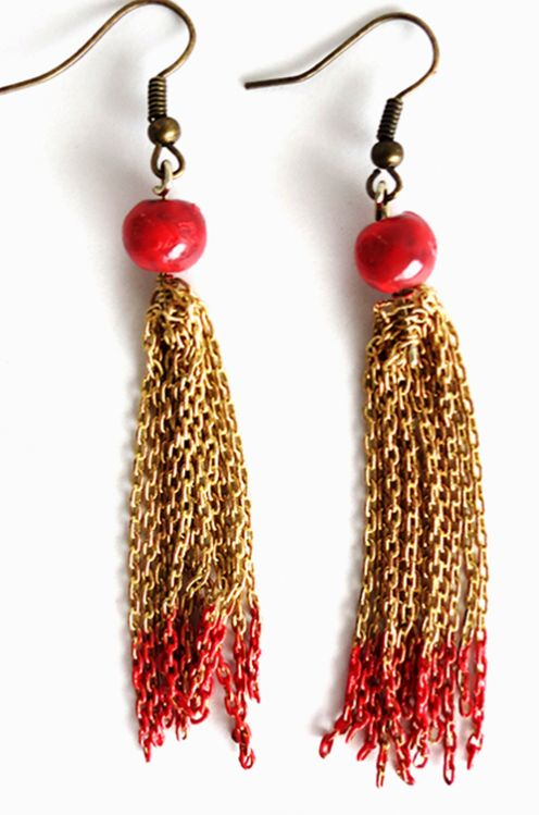 Nothing screams the holidays like some apple red and metallic gold earrings. These stunning Red and Gold Chained Tassel Earrings are the star on top of your Christmas tree in completing your outfit.