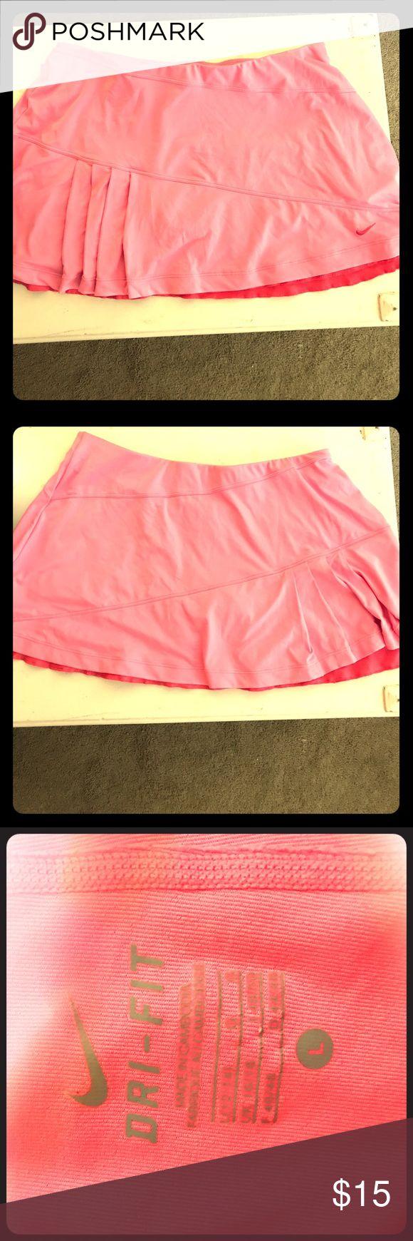 Hot Pink Nike Tennis Skort Nike Women's Dri-fit tennis skort. Worn twice. In perfect condition! Has built in shorts. Nike Skirts