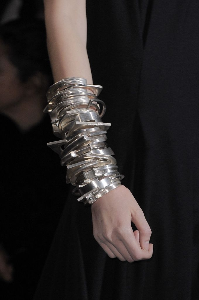 Stacked silver cuffs and bracelets give a mechanical twist to #AW14 from Ann Demeulemeester #PFW