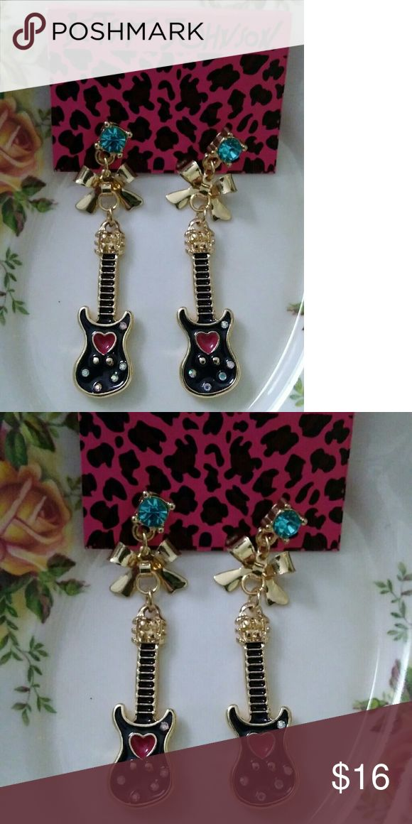 Betsey Johnson guitar heart drop earrings These are so cool. Little black guitars with hearts, gold bows, and a blue jewel up top. 2 inches long. Betsey Johnson Jewelry Earrings