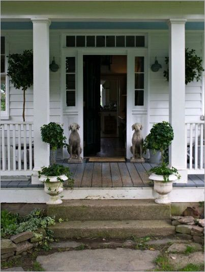 I seriously <3 the dogs on either side of the door. Lovely front porch - 19 Best Architecture {Porches} Images On Pinterest Doors, Home