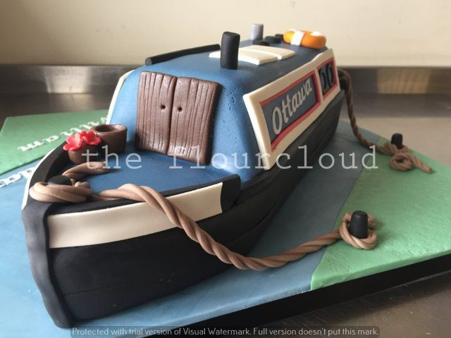Narrowboat on the canal birthday cake.