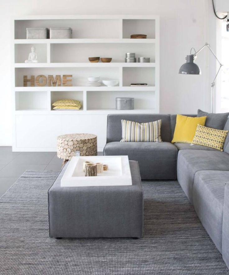 Minimalistic, but not too cold. Maybe a throw over the couch would make it more welcoming? A black and white print? Herringbone?