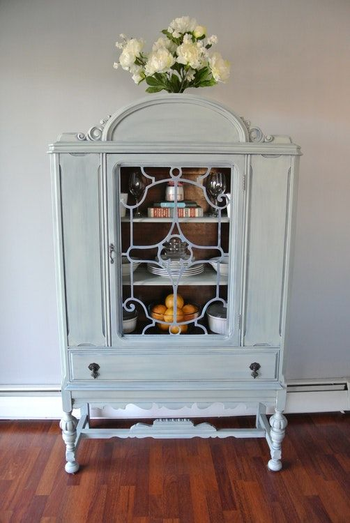 Amazing one of a kind refinished Jacobean style / Depression Era china cabinet / hutch that is shabby chic, a pale blue 'washed' blue with small bits of dark blue poking through. Perfect ...