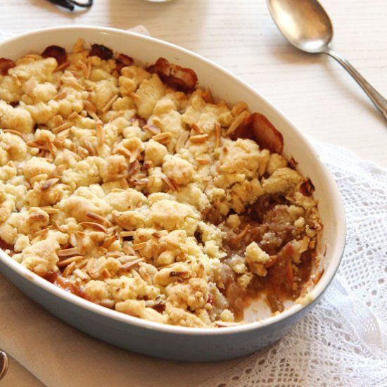 delicious rhubarb apple crumble with almonds, served with custard ...