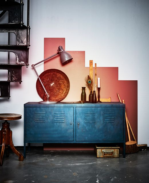 A newly made over metal cabinet sits against a graphically painted wall. -- I like the idea of doing this for the garage