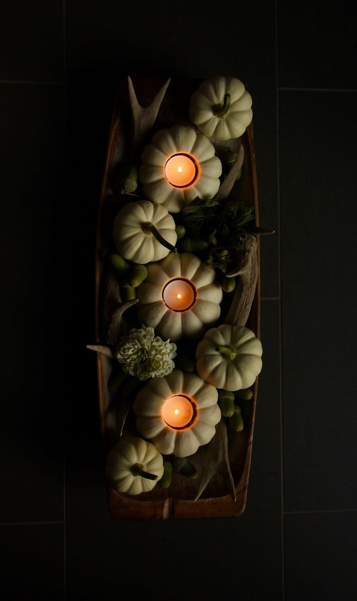 This white pumpkin centerpiece is such an easy fall decor DIY! The mini pumpkin tea lights are quick to make and will light up your autumn table beautifully   Home for the Harvest #minipumpkins #pumpkins #pumpkincenterpiece #pumpkin #falldecor #autumndecor #homefortheharvest
