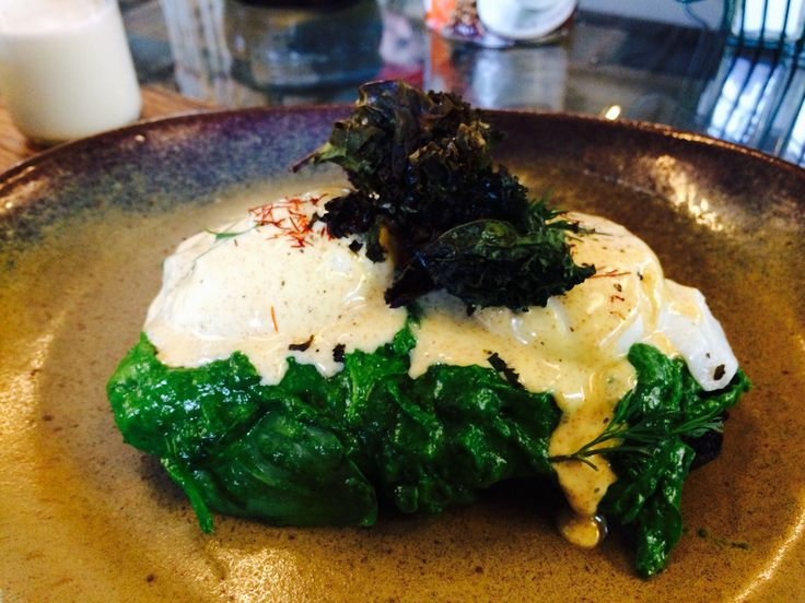 Eggs florentine with creamed spinach, kale chips, gluten free toast and poached eggs.
