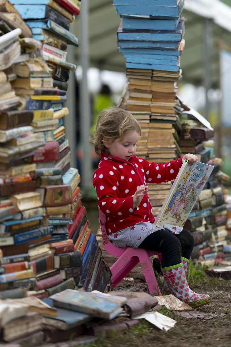 Three-year-old Maeve Magee read a book during Wales's Hay Festival, an annual festival of literature and the arts.