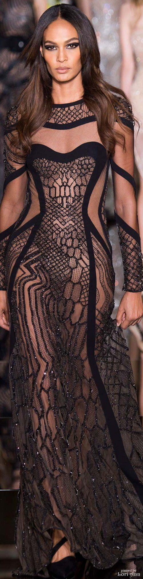 Atelier Versace Spring 2015. There is something really fantastic and unusual about this black, sheer and nude gown. Granted, one would probably need to be rather brave to wear this, but all credit where it's due if you are! It is fab.