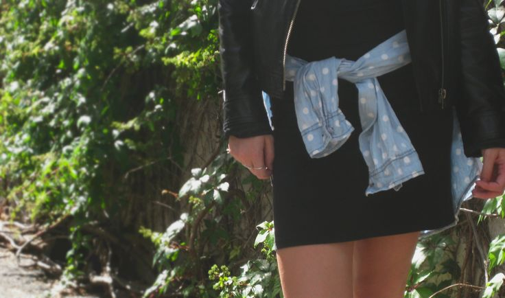 Black slip dress with polka dot shirt and leather jacket