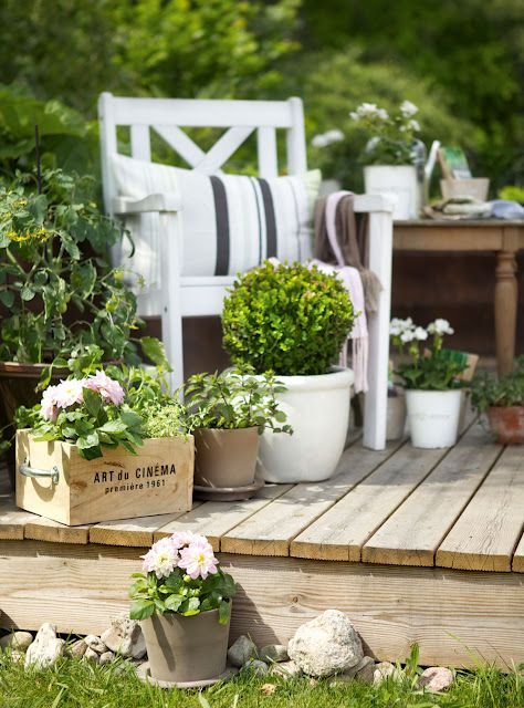 Garden chair, cushions & decking ~ lovingly repinned by www.skipperwoodhome.co.uk