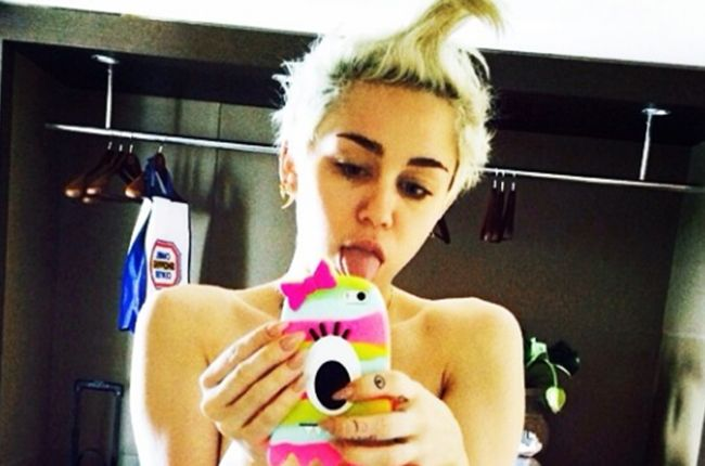 Miley Cyrus Shares Topless Photos of New Tattoo Honoring Her Late Dog | Billboard