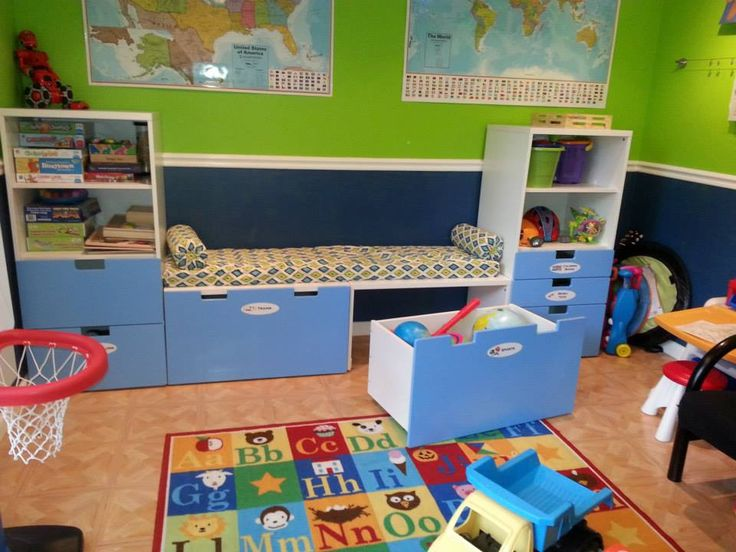 Our Playroom: IKEA Stuva storage. I love the toy chests on casters under the benches! Access while still sitting and no pinched fingers. Cushions are homemade.
