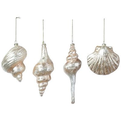 Best Coastal Ornaments: Shell ornaments done in classic white have a pearl-like sheen to them. | CoastalLiving.com