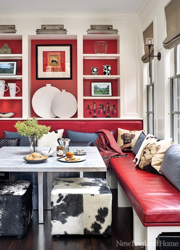 """In a Beacon Hill home, a red-leather corner banquette cozies up to a marble-topped table in the """"flop room"""" off the kitchen. Photo by Bruce Buck."""