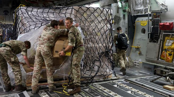 In this undated photo provided on Sunday Sept. 10, 2017, by the British Ministry of Defence, military personnel unload aid cargo and water upon their arrival at Grantley Adams International Airport, Barbados. The death toll from Hurricane Irma has risen to 22 as the storm continues its destructive path through the Caribbean. (Jimmy Wise/MOD via AP)