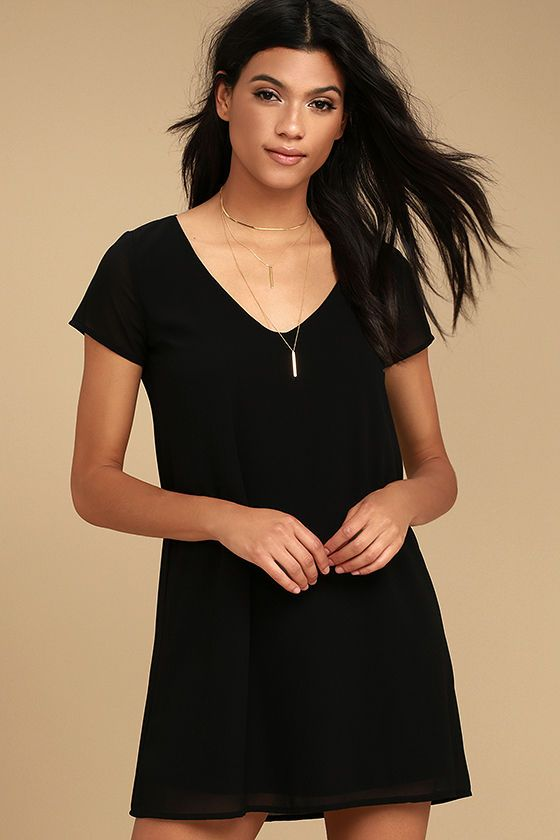Endless styling possibilities are at your fingertips with the Freestyle Black Shift Dress! Sleek woven poly shapes this short sleeve shirt dress with deep, V-neck and chic, shift silhouette.