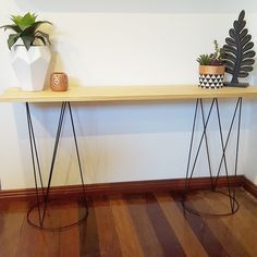 Plant stands sprayed black and used as hall table. Kmart Australia style. Kmart hacks.Seen on FB