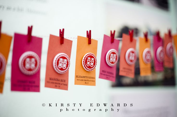 Escort cards with the double happiness Chinese symbol. Beth & Jeff // Kirsty Edwards Photography