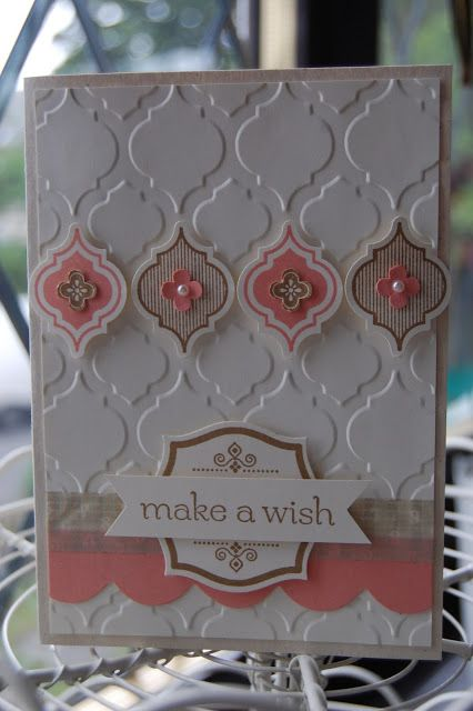 I like the use of an embossing plate in the background and then echoing it in color on top.
