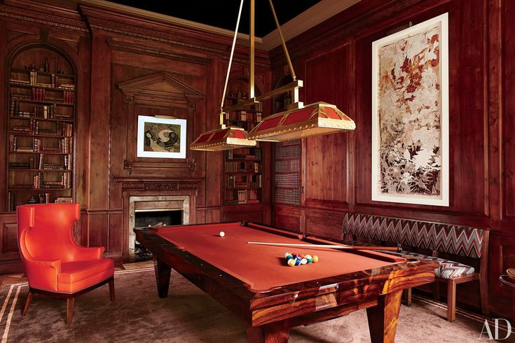 A pool table, an Art Deco light fixture, and a 1930s French oil painting strike perfect period notes in the paneled billiard room of a New York home decorated by S.R. Gambrel Inc. Photo: Oberto Gili