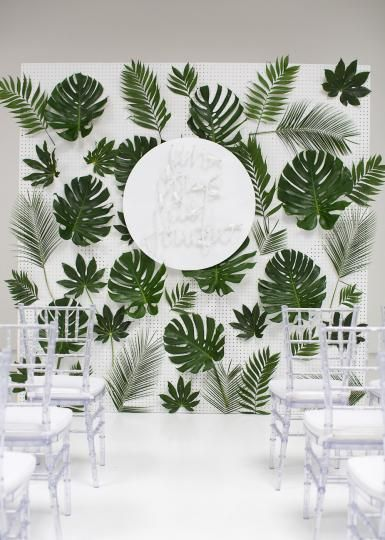 Tropical inspired altar by Bows + Arrows at 129 Leslie. Rentals from AFR Event Furnishings. Photo by Sarah Kate, Photographer. #wedding #altar #tropical #white #green #leaves #modern