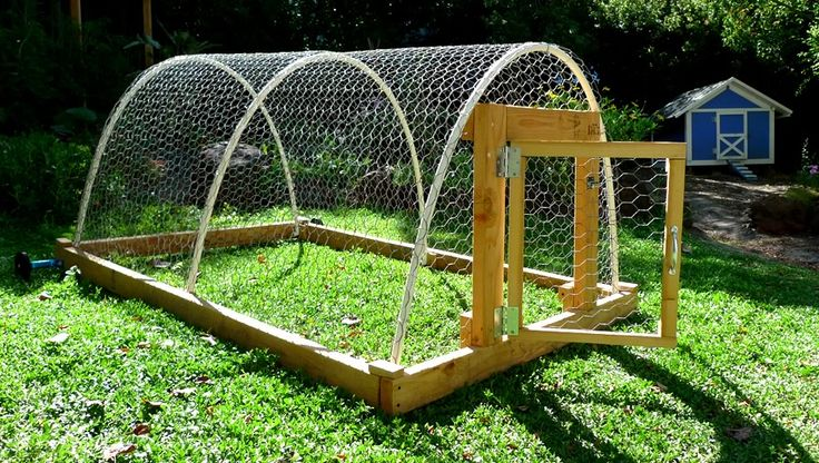 I showed this image to our farm-hand and he is building this chicken tractor right now in the barn :)  Ours will be bigger and have laying boxes in the back.