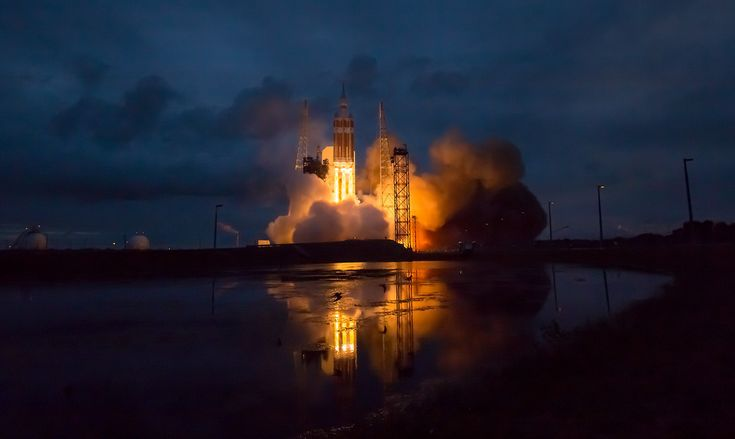 The United Launch Alliance Delta IV Heavy rocket with NASA's Orion spacecraft mounted atop, lifts off from Cape Canaveral Air Force Station's Space Launch Complex 37 at at 7:05 a.m. EST, Friday, December 5, 2014, in Florida. [5055 x...
