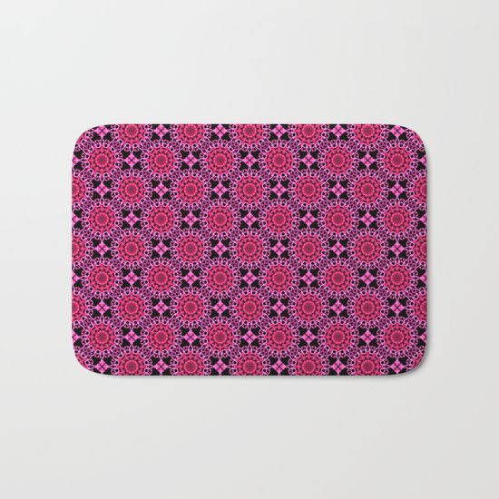 Medallion Pattern Magenta Bath Mat by Terrella.  The perfect bath mats: fuzzy, foamy and finely enhanced with brilliant art. With a soft, quick-dry microfiber surface, memory foam cushion and skid-proof backing, our shower mats are a cut above your typical rug. Keep them clean with a gentle machine wash (no bleach!) and make sure to hang dry.