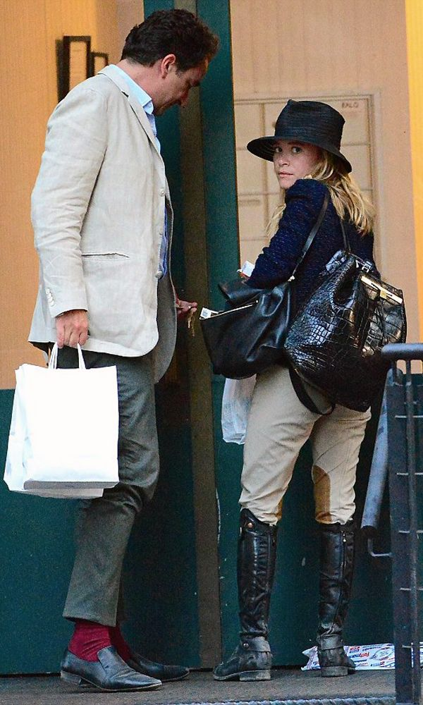 Mary-Kate Olsen and her fiancé Olivier Sarkozy stepped out in NYC. MK is wearing a blue tweed jacket and riding pants. #style #fashion #olsentwins