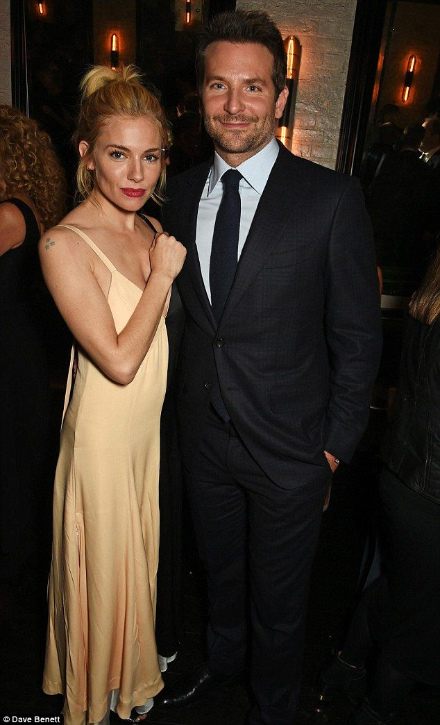 Her leading man: The actress also cosied up to her Burnt co-star Bradley Cooper at the star-studded bash