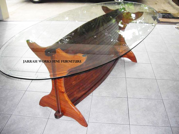 Oval Glass topped Dining table made with recycled Ipil and Narra timber